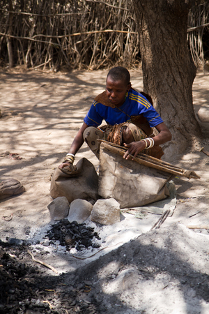 hunter gatherer: datoga tribe lighting fire to forge iron, zanzibar