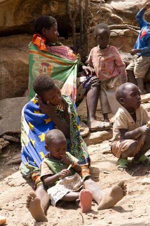 hunter gatherer: hadzabe women sitting together with their children Editorial