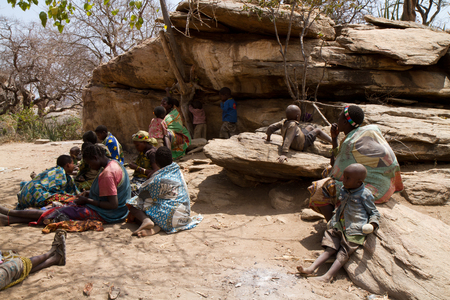 hunter gatherer: hadzabe tribe, women and their children sitting together, tanzania