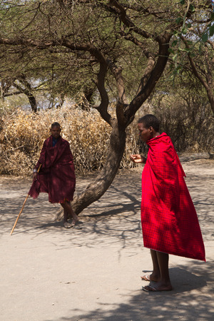 hunter gatherer: datonga tribe two men under the shade of a tree Editorial