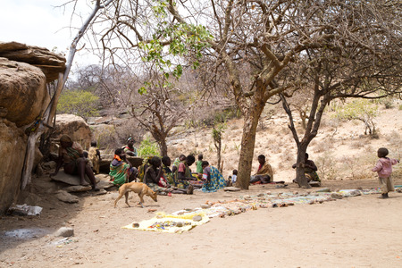 gatherer: hadzabe tribe women sitting with their childrel