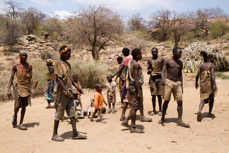 hunter gatherer: hadzabe tribe dancing together in the village, tanzania