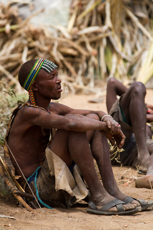 hunter gatherer: hadzabe hunter resting in his village in tanzania