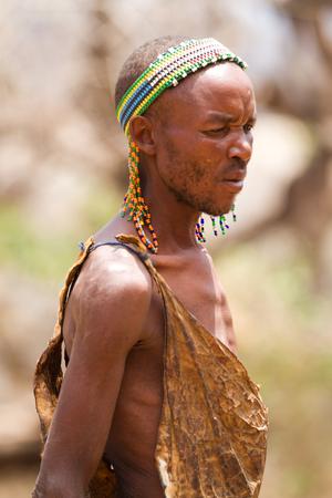 hunter gatherer: hadzabe tribesman portrait Editorial