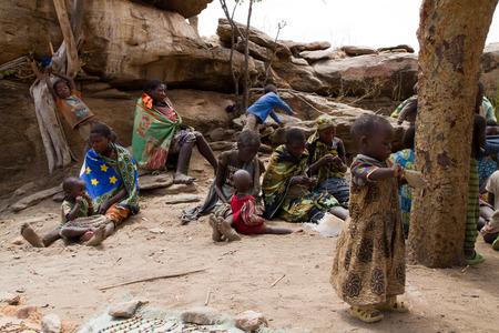 gatherer: hadzabe tribe, women sitting with their children, tanzania