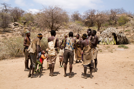 hunter gatherer: hadzabe people dancing together in their village Editorial