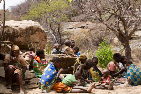 gatherer: hadzabe tribe, women and their children in the small village, tanzania