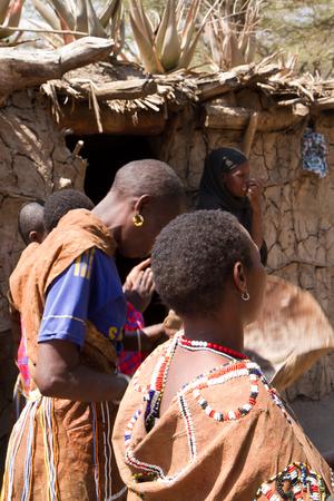hunter gatherer: datoga woman in their village in tanzania