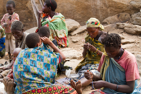 the passing of time: hadzabe women sitting around passing time