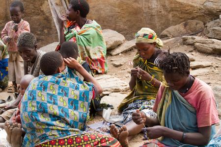 gatherer: hadzabe women sitting around passing time