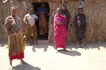 hunter gatherer: datoga tribe women in front of their hut Editorial