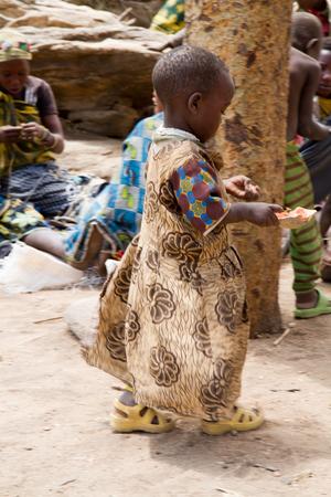 hunter gatherer: hadzabe tribe young child in the village, tanzania