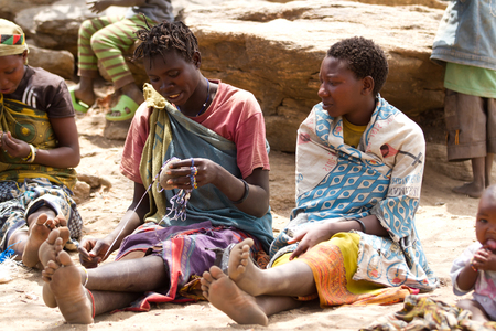 hunter gatherer: hadzabe tribe women sitting and resting in the village, tanzania Editorial