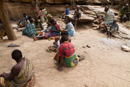 hunter gatherer: hadzabe tribe woman sitting together with their children
