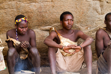 hunter gatherer: hadzabe men sitting in the shade