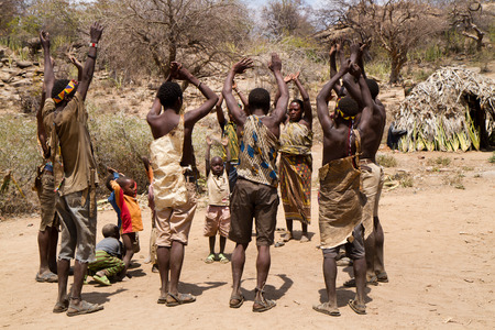 hunter gatherer: hadzabe people dancing in their village