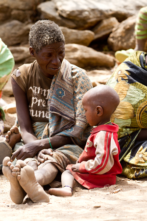 gatherer: hadzabe grandmother with her nephew, only 1000 people are left of this tribe Editorial