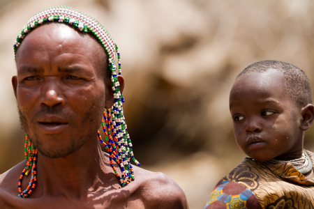 hunter gatherer: hadzabe people in a village of tanzania