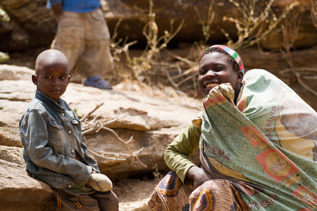 gatherer: hadzabe mother with her son, only 1000 people are left of this tribe of tanzania Editorial