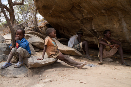 hunter gatherer: hadzabe tribe men with children in thi tribe of tanzania Editorial