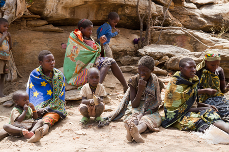 hunter gatherer: hadzabe tribe people sitting together