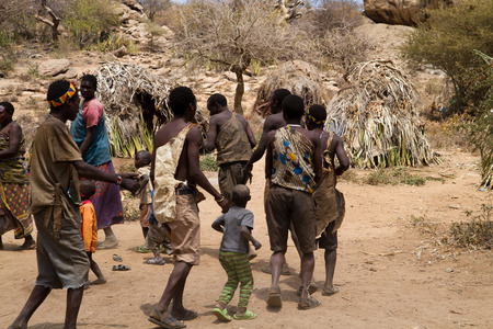 hunter gatherer: hadzabe tribe people dancing in the village