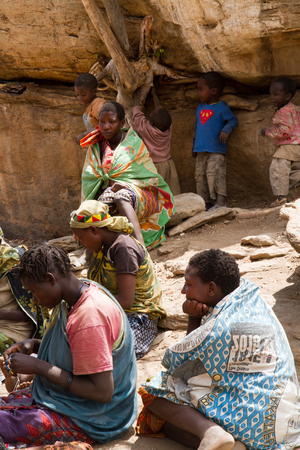 hunter gatherer: hadzabe women sitting together in a village in tanzania