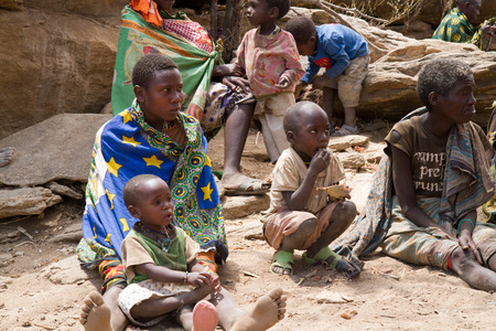 hunter gatherer: hadzabe peopole sitting together, only 1000 people are left of this tribe