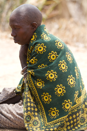 hunter gatherer: hadzabe woman with her colorful dress Editorial