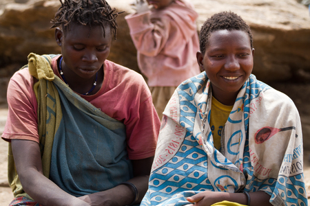 hunter gatherer: hadzabe tribe two woman sitting together Editorial