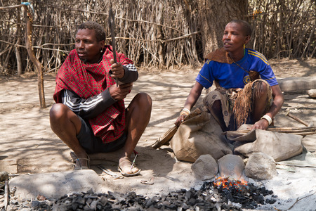 hunter gatherer: datoga people while forging the iron