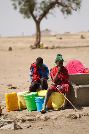 village man: oldonyo masai village man resting in the sun