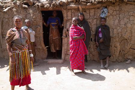 hunter gatherer: datoga tribeswoman near their hut Editorial