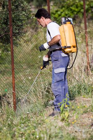 farmer spraying pesticide Stock Photo