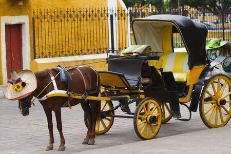 colonial house: izamal carriage in the centre of the town, mexico Stock Photo