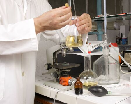 technologist: chemist working in his lab Stock Photo