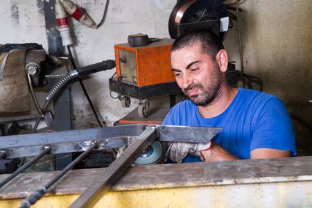 steelworks: metalworker at work in his workshop