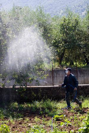 farmer using pesticide Stock Photo