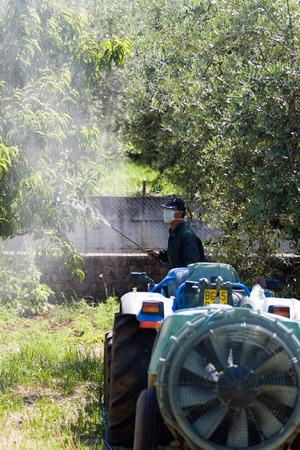 farming man using pesticide