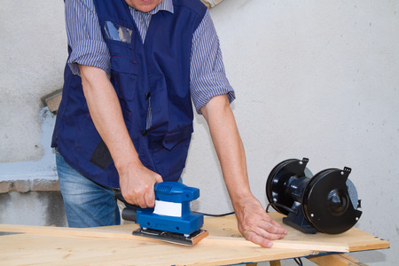 smoothing: smoothing a piece of wood for furniture