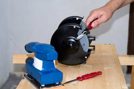 sharpening process: sharpening a kitchen knife with a machinery