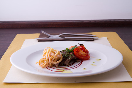 sliced beef served with home made pasta and tomato Stock Photo