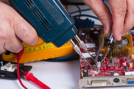 electrician fixing electrical device