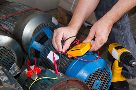 repairman during maintenance work of electric motors Banque d'images