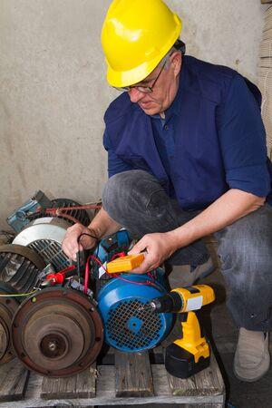 repairman during maintenance work of electric motors Foto de archivo
