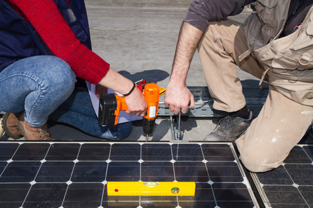 skilled technicians working on a photovoltaic plant