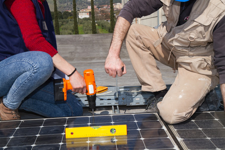skilled technicians working on a photovoltaic plant Standard-Bild - 113789484