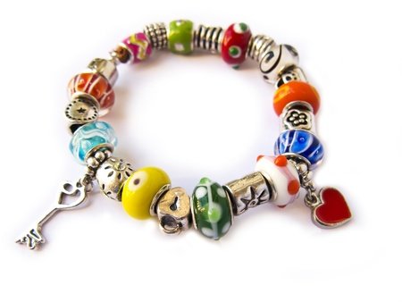 Beads and gems bracelet isolated in white photo