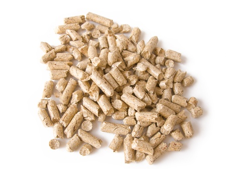 Wood pellets background close up. Isolated in white Stock Photo