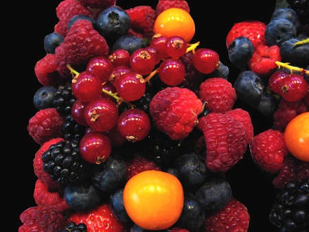 fruit stand: Fruits market (La Boqueria,Barcelona famous marketplace). Red and black berries Stock Photo